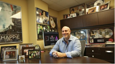 Songwriter and business owner Jason Davis sits in his office filled with music memorabilia in Delray Beach, Florida.